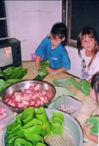 Kids making lau lau